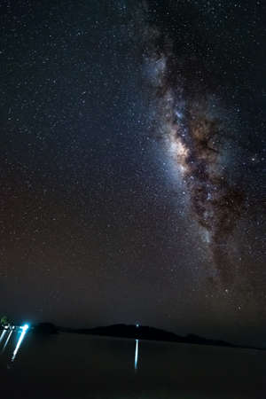 acceptable: Gorgeous bright Milky Way and starry sky viewed from the remote Malenge, Togian (or Togean) Islands, Sulawesi, Indonesia. Long exposure, some acceptable grain. Stock Photo