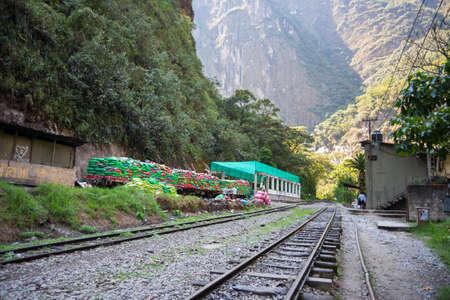 hydroelectric station: Machu Picchu, Peru - September 8, 2015: Train full of garbage ready to travel out of Machu Picchu, Peru. The railroad track connects Machu Picchu village to Hydroelectric Station and its used for tourism and cargo purpose. Editorial