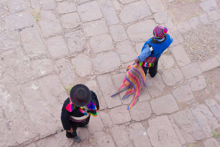 directly above: Taquile, Peru - September 1, 2015: Directly above view of traditionally dressed men in Taquile Island, Titicaca Lake, Peru. About 2200 people live on the island. They speak Quechua language. Editorial