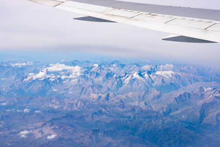 expansive: Aerial view of the Alps, Ecrins National Park, France, shot from aeroplane. High altitude mountain range and glaciers. Expansive view. Stock Photo