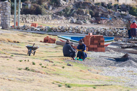 peruvian ethnicity: Island of the Sun, Bolivia - August 20, 2015: Rural life on the Island of the Sun, Titicaca Lake, Bolivia. About 800 families live on the island. They speak Aymara and Quechua language.