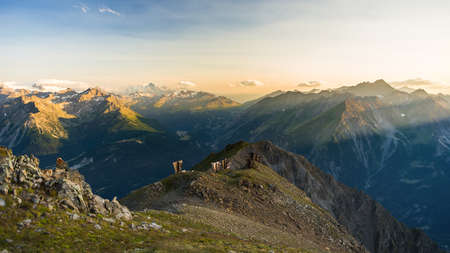 extreme terrain: Last soft sunlight over rocky mountain peaks, ridges and valleys of the Alps at sunrise. Extreme terrain landscape at high altitude in Valle dAosta, scenic travel destination in Italy.