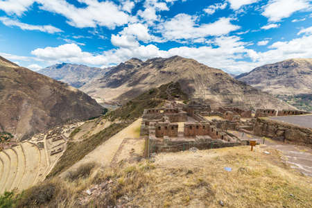 expansive: Expansive view of the Sacred Valley, Peru from Pisac Inca site, major travel destination in Cusco region, Peru. Ancient Inca ruins in the foreground.