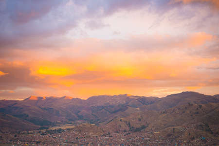 colorful cloudscape: Panoramic view of Cusco town with glowing cloudscape and colorful sky at dusk. Cusco is among the most important travel destination in Peru and the entire South America.