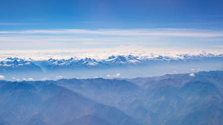 expansive: Aerial view of the Peruvian Andes, shot from aeroplane. High altitude mountain range and glaciers. Expansive view.