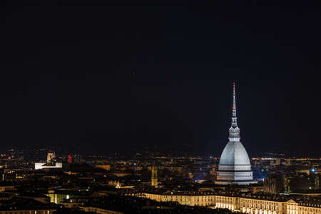soul searching: Panorama of Torino (Turin), Piedmont, Italy, with wonderful starry sky. Cityscape from above with the Mole Antonelliana towering on the city and glowing in the night.