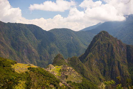 urubamba valley: Wide angle panoramic view of Machu Picchu, illuminated by afternoon sunlight, and the majestic Urubamba Valley from the Inca Trail to the Sun Gate.