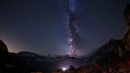 soul searching: The outstanding beauty of the Milky Way arc and the starry sky captured at high altitude in summertime on the Italian Alps, Torino Province. Fisheye scenic distortion and 180 degree view.