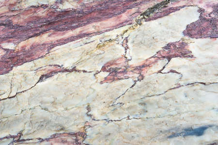 metamorphic: Close up of colorful rock surface, natural background, pattern and texture. Metamorphic white quartzite folded and fractured together with red coarse sandstone, due to the power of geologic crustal movement. Stock Photo