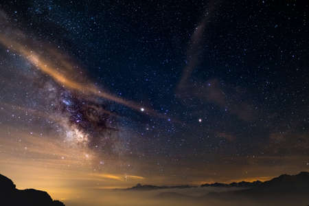 soul searching: The colorful glowing core of the Milky Way and the starry sky captured at high altitude in summertime on the Italian Alps, Torino Province. Mars and Saturn glowing mid frame.