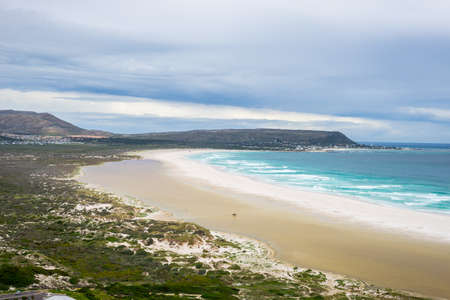 table mountain national park: The scenic Noordhoek beach with dramatic sky in winter. Panoramic view from Chapmans Peak Drive, Cape Peninsula, Cape Town, South Africa.