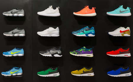 footwears: Johannesburg, South Africa - September 12, 2016: Colorful Nike footwears exhibition on black shelf in store of Johannesburg, South Africa. Nike Inc. is an American multinational corporation for the design, manufacturing and worldwide marketing of sportwea
