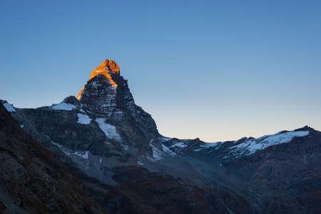 Sunset light over the elegant Matterhorn or Cervino summit (4478 m), italian side, Valle dAosta.