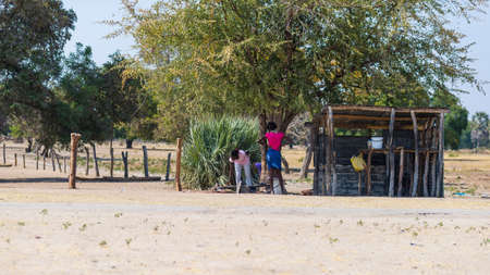 primitivism: Caprivi, Namibia - August 20, 2016: Poor people working in their village in the rural Caprivi Strip, the most populated region in Namibia, Africa.