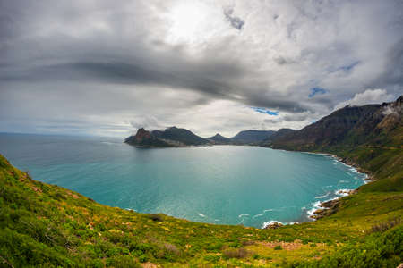 chapmans: Fisheye ultrawide view of Hout Bay, Cape Town, South Africa, from Chapmans Peak. Winter season, cloudy and dramatic sky.