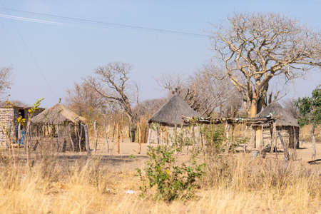 thatched roof: Mud straw and wooden hut with thatched roof in the bush. Local village in the rural Caprivi Strip, the most populated region in Namibia, Africa. Stock Photo