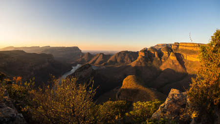Blyde River Canyon, famous travel destination in South Africa. Last sunlight on the mountain ridges. Ultra wide angle view from above.   Stock Photo