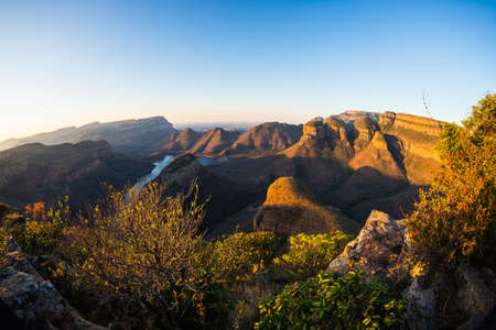 Blyde River Canyon, famous travel destination in South Africa. Last sunlight on the mountain ridges. Fisheye view from above.   Stock Photo