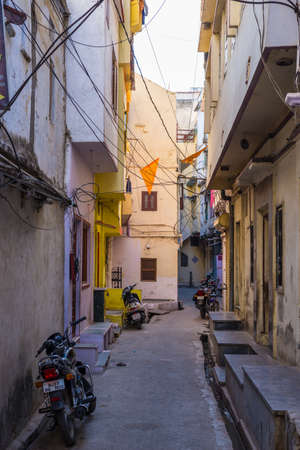 Udaipur, India - January 29, 2017: Walking in the enchanting narrow alleys and streets at Udaipur, famous travel destination in Rajasthan, India.