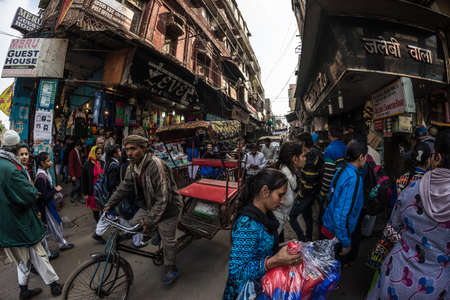 Delhi, India - January 27, 2017: Crowd, food stalls and traffic at Chandni Chowk, Old Delhi, famous travel destination in India. Fisheye view. Editorial