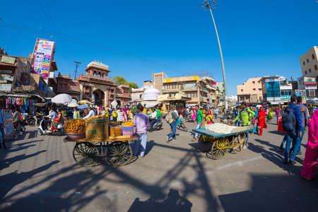 fish vendor: Jodhpur, India - February 24, 2017: crowd, market and food stalls in Jodhpur, famous travel destination in Rajasthan, India. Editorial