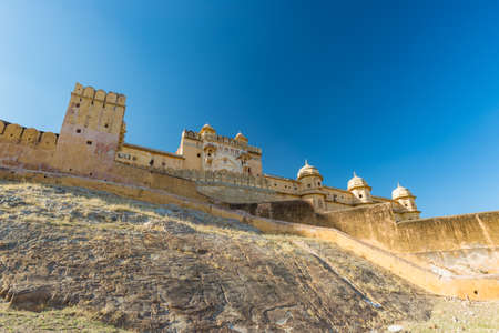 The impressive landscape and cityscape at Amber Fort, famous travel destination in Jaipur, Rajasthan, India. Wide angle view from below. Stock Photo