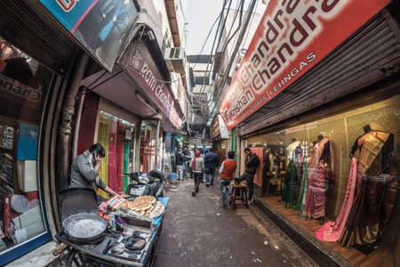 rickshaw: Delhi, India - January 27, 2017: ordinary crowdy city life at Chandni Chowk, Old Delhi, famous travel destination in India. Fisheye view.