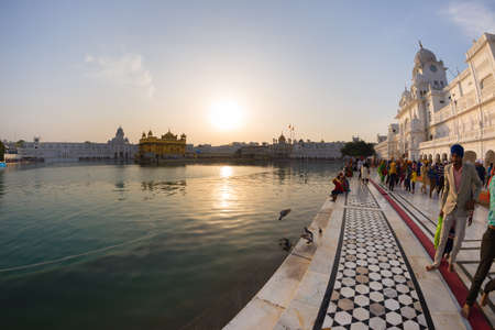 Amritsar, India - March 18, 2017: Tourists and worshipper inside the Golden Temple complex at Amritsar, Punjab, India, the most sacred icon and worship place of Sikh religion.