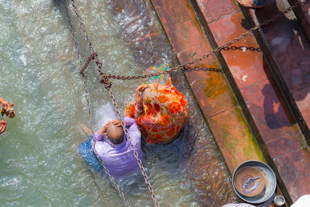 woman in bath: Haridwar, India - March 11, 2017: unidentified people bathing and taking ablutions in the Ganges River at the Holy ghats in Haridwar, India, sacred town for Hindu religion.