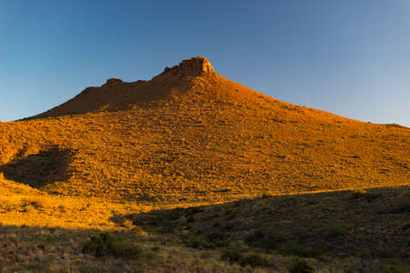 Majestic landscape at Karoo National Park, South Africa. Scenic table mountains, canyons and cliffs at sunset. Adventure and exploration in Africa, summer vacations. Stock Photo