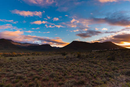 Majestic landscape at Karoo National Park, South Africa. Scenic table mountains, canyons and cliffs at sunset. Adventure and exploration in Africa, summer vacations. Stok Fotoğraf