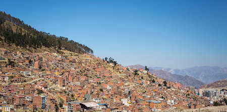Cityscape of La Paz from El Alto, Bolivia, with the stunning snowcapped mountain range in the background.