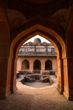 Mandu India, afghan ruins of islam kingdom, mosque monument and muslim tomb. View through door, Jahaz Mahal. Stock Photo