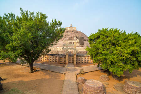 Sanchi Stupa, Madhya Pradesh, India. Ancient buddhist building, religion mystery, carved stone. Sunrise sky.