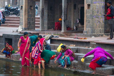 Ujjain, India - December 7, 2017:  People attending religious ceremony on holy river at Ujjain, India, sacred town for Hindu religion.