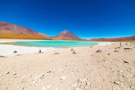 Green Lagoon or Laguna Verde, frozen salt lakeroad trip to the famous Uyuni Salt Flat, travel destination in Bolivia. Snowcapped Licancabur Volcano, 5920 m, in the background.