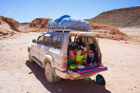 Huayllajc, Bolivia - August 26, 2015: 4x4 vehicle taking tourists on the desertic highlands of the Andes in Huayllajc, Bolivia, roadtrip to the world famous Uyuni Salt Flat.
