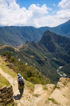 Backpacker on Inca Trail, exploration of Machu Picchu, the most visited travel destination in Peru. Summer adventures in South America.