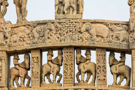 Sanchi Stupa, ancient buddhist hindu statue details, religion mystery, carved stone. Travel destination in Madhya Pradesh, India.