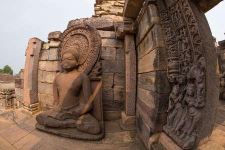 Sanchi Stupa, ancient Buddha statue details, religion mystery, carved stone. Travel destination in Madhya Pradesh, India.