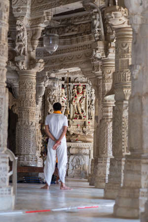 Ranakpur, India - February 2, 2017: people in the majestic jainist temple at Ranakpur, Rajasthan, India. Architectural details of stone carvings. Editorial