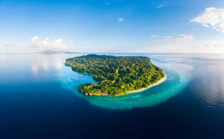 Aerial view tropical beach island reef caribbean sea. Indonesia Moluccas archipelago, Banda Islands, Pulau Ay. Top travel tourist destination, best diving snorkeling. Stock Photo