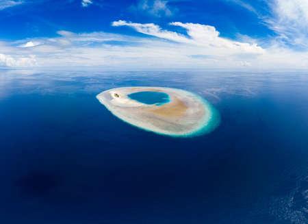 Aerial idyllic atoll, scenic travel destination Maldives Polinesia. Blue lagoon and turquoise coral reef. Shot in Wakatobi National Park, Indonesia