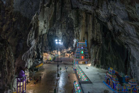 Batu Caves Kuala Lumpur Malaysia, scenic interior limestone cavern decorated with temples and Hindu shrines, travel destination in South East Asia trip. 免版税图像