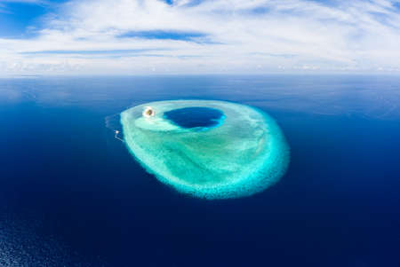 Aerial idyllic atoll, scenic travel destination Maldives Polinesia. Blue lagoon and turquoise coral reef. Shot in Wakatobi National Park, Indonesia Archivio Fotografico