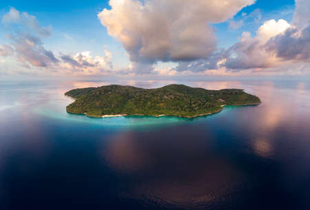 Aerial view tropical beach island reef caribbean sea. Indonesia Moluccas archipelago, Banda Islands, Pulau Hatta. Top travel tourist destination, best diving snorkeling. Stock Photo