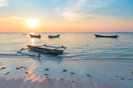 Sunset tropical beach caribbean sea wooden boats at Pasir Panjang. Indonesia Moluccas archipelago, Kei Islands, Banda Sea. Top travel destination, best diving snorkeling, stunning panorama.