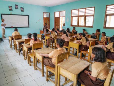 Kei Kecil, Indonesia - October 20, 2018: european teacher holding class in local school, Ngilgof village, Kei Islands, Moluccas, Indonesia