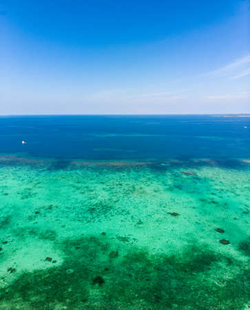 Aerial view coral reef tropical caribbean sea, turquoise blue water. Indonesia Moluccas archipelago, Kei Islands, Banda Sea. Top travel destination, best diving snorkeling.