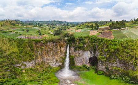 Aerial view Sipiso-piso waterfall in Sumatra, travel destination in Berastagi and Lake Toba, Indonesia.